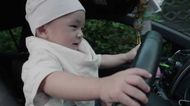 mother with baby boy traveling in car - baby boys stock videos and b-roll footage