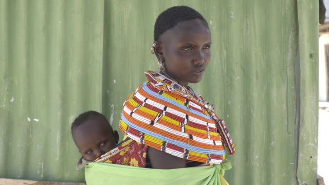 mother with baby, from samburu tribe. kenya. africa. - baby carrier stock videos & royalty-free footage