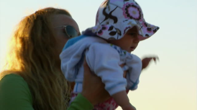 stockvideo's en b-roll-footage met cu, mother with baby girl (6-12 months) sitting on beach, north truro, massachusetts, usa - 6 11 maanden