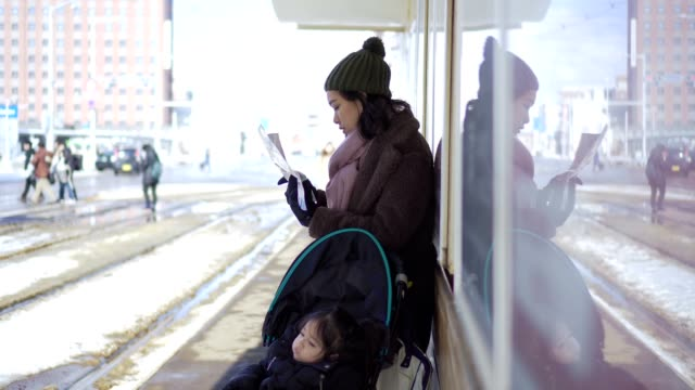mother with baby stroller waiting for the train - three wheeled pushchair stock videos & royalty-free footage