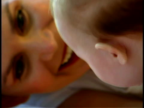 mother with baby - unknown gender stock videos & royalty-free footage