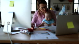 Mother with baby working from Home