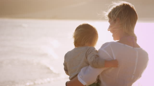 mother with child on the beach - emotion stock videos & royalty-free footage