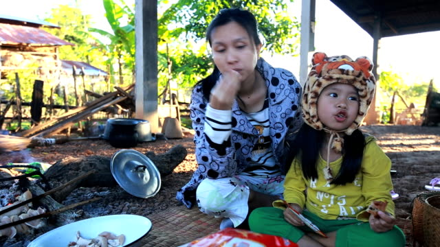 mother with child seat asians eat breakfast. - naked stock videos & royalty-free footage