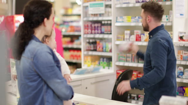 mother with daughter at pharmacy - comment box stock videos & royalty-free footage