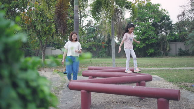 mother with daughter happiness outdoor learning in the public park - balance stock videos & royalty-free footage