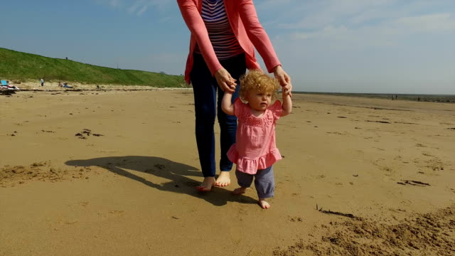 mother with daughter on beach - 12 17 months stock videos & royalty-free footage