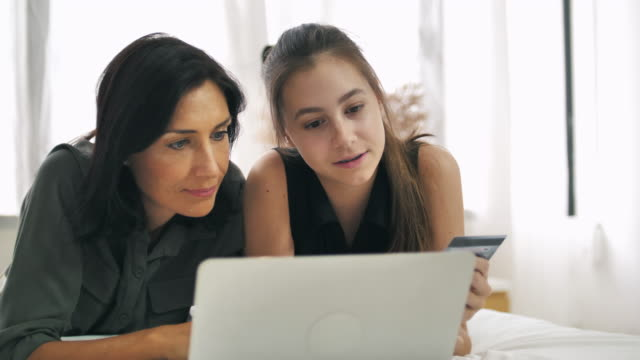 mother with daughter online shopping at home - online shopping stock videos & royalty-free footage