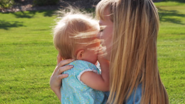 slo mo ms mother with daughter (6-11 months) playing in park / utah, usa - 6 11 months stock videos & royalty-free footage