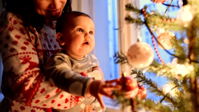 mother with daughter portrait at christmas - christmas bauble stock videos & royalty-free footage