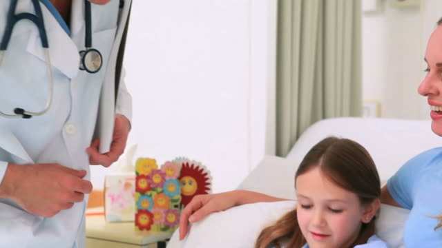 mother with her daughter recovering in hospital - haarzopf stock-videos und b-roll-filmmaterial