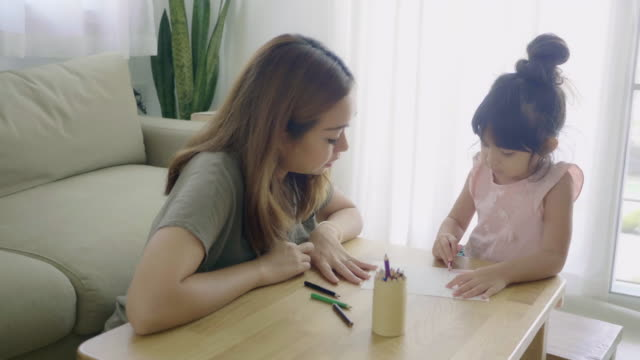 mother with daughter studying at home - pencil isolated stock videos & royalty-free footage