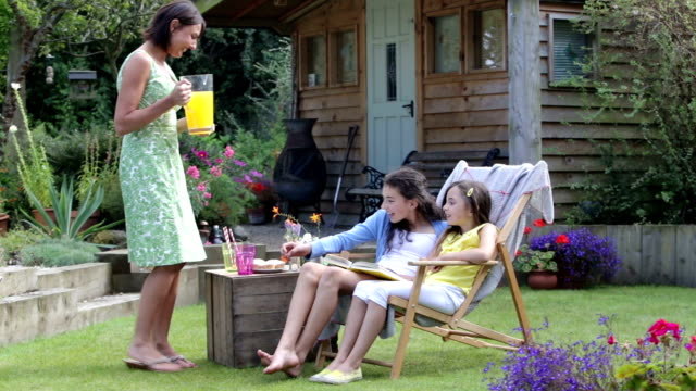 mother with daughters in the garden - shed stock videos & royalty-free footage