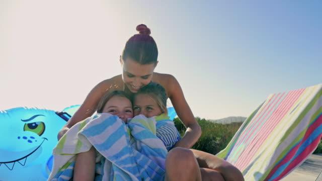 stockvideo's en b-roll-footage met mother with daughters sitting - in een handdoek gewikkeld