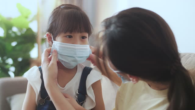 mother with face mask daughter - safety stock videos & royalty-free footage