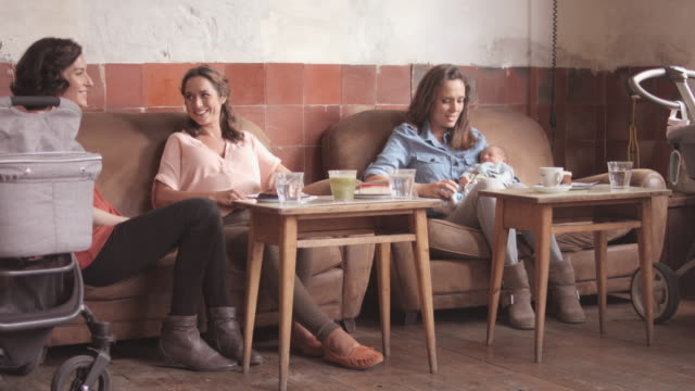 Mother with friends talking in restaurant
