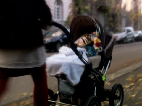 mother with preambulator sweden. - sportkinderwagen stock-videos und b-roll-filmmaterial