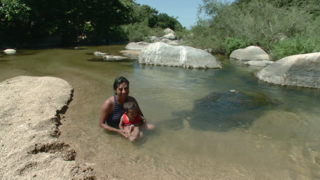 ws mother with son (18-23 months) in river / yelapa, jalisco, mexico - 18 23 months stock videos & royalty-free footage