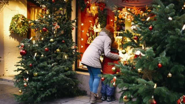 mother with son  standing near christmas tree in rothenburg - rothenburg stock videos and b-roll footage