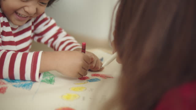 mother with son studying at home - crayon stock videos & royalty-free footage