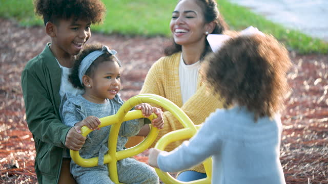 mother with three children on playground, seesaw - family with three children stock videos & royalty-free footage