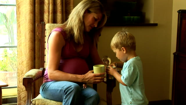 mother  with toddler son - tre quarti video stock e b–roll