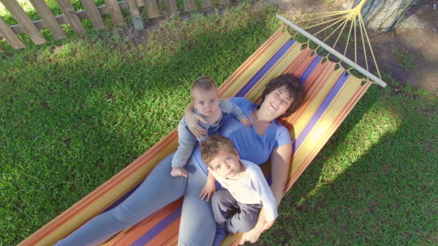 Mother with two sons in hammock