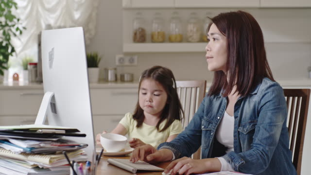 mother working from home and interacting with daughter - saucer stock videos & royalty-free footage