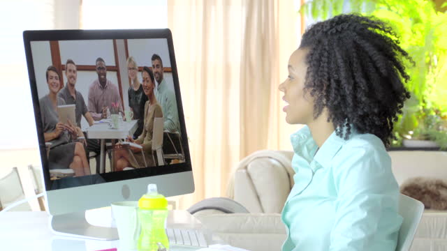 mother working from home having a teleconference business meeting - voip stock videos & royalty-free footage