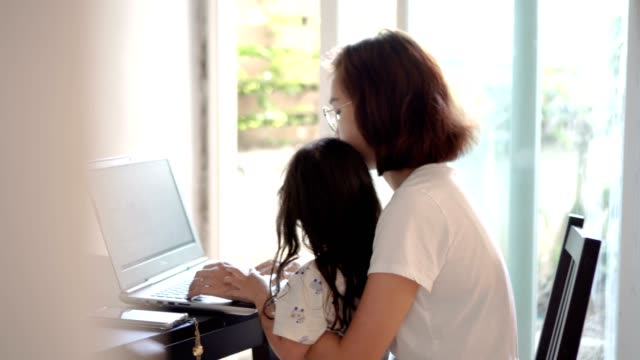 mother working from home using laptop - young family stock videos & royalty-free footage