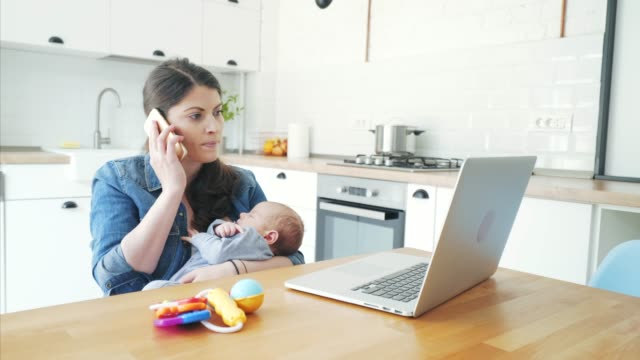mother working remotely at home. - single mother stock videos & royalty-free footage