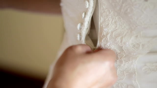 mother zipping up bride's wedding dress. - wedding dress stock videos and b-roll footage