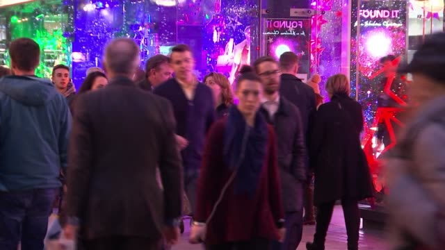 Mothercare profits warning following sales slump R16121518 Brass band playing in street Christmas shoppers along busy Oxford Street Christmas...