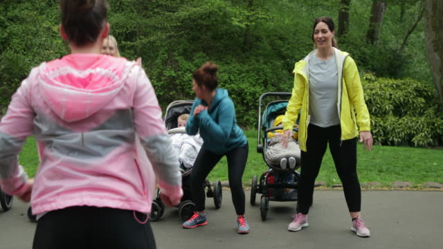 mothers and babies exercising - mother stock videos & royalty-free footage
