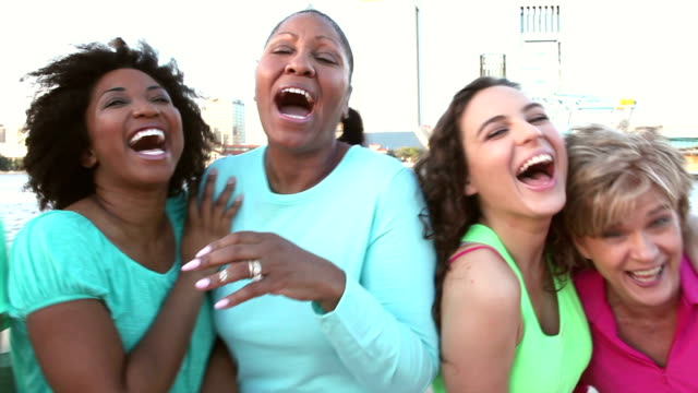 mothers and daughters together on city waterfront - women in a row stock videos & royalty-free footage