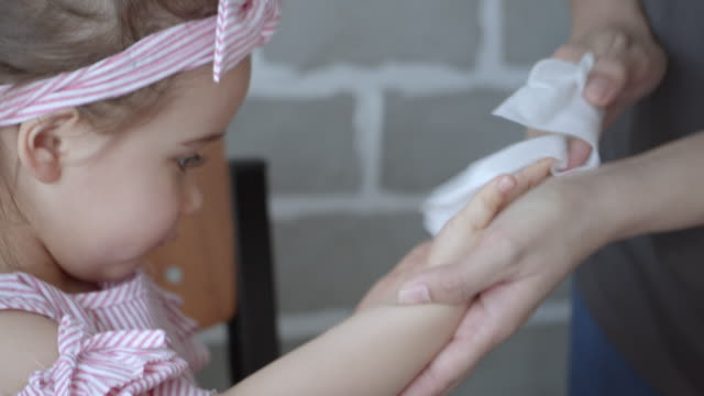 mothers cleaning mouth and hands of the daughter,slow motion - tissue paper stock videos & royalty-free footage