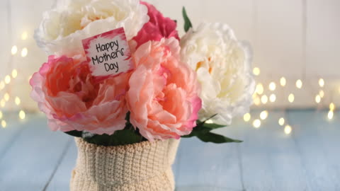mother`s day arrangement and a greeting card - mother's day stock videos & royalty-free footage