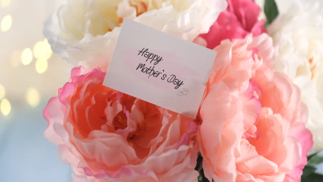 mother`s day arrangement and a greeting card - bunches stock videos & royalty-free footage