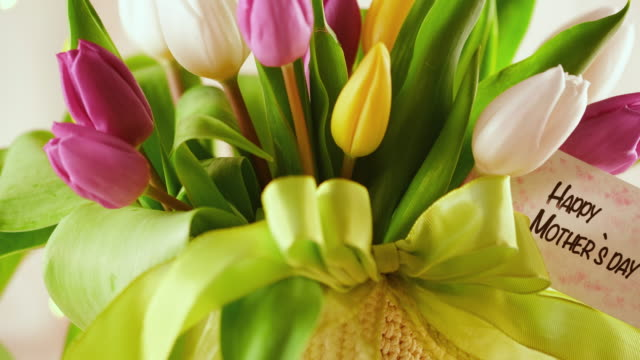 mother`s day arrangement with tulip bouquet - bouquet stock videos & royalty-free footage