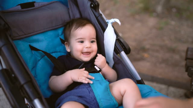 mother's hand playing with her baby son in the pram - pushchair stock videos & royalty-free footage