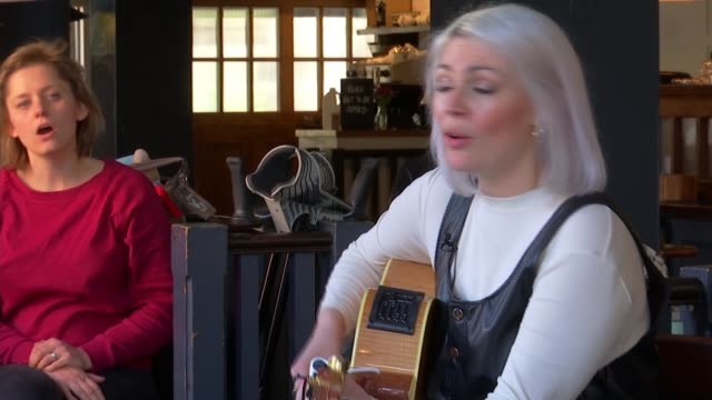mothers hold concert to raise awareness for postpartum psychosis england london sot*** various of mothers and children sat in café singing sot naomi... - psychosis stock videos & royalty-free footage