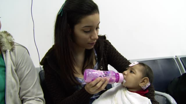 Mothers of children born with microcephaly come to the Brazil's State Brain Institute for medical checkups in Rio de Janeiro Brazil on September 15th...
