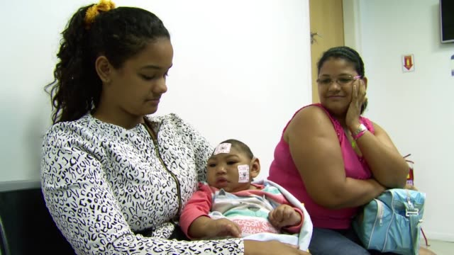 mothers of children born with microcephaly come to the brazil's state brain institute for medical check-ups in rio de janeiro, brazil on september... - virus zika video stock e b–roll
