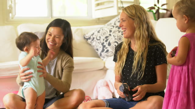 stockvideo's en b-roll-footage met ms mothers playing with their babies. - in kleermakerszit