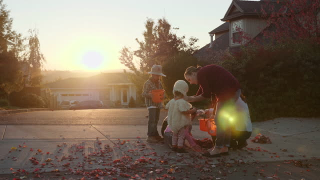 slo mo: mothers preparing their kids for trick or treating - candy stock videos & royalty-free footage