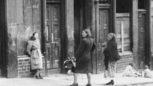 1944 montage mothers standing and talking outside their city homes while children are playing on the sidewalk / scotland, united kingdom - 1944 stock videos & royalty-free footage