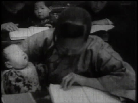 1932 cu mothers studying with babies beside them in class / china - single mother stock videos & royalty-free footage