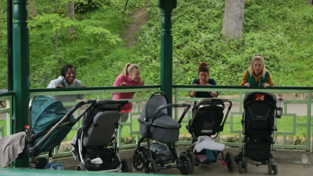 mothers workout on a bandstand - bandstand stock videos and b-roll footage