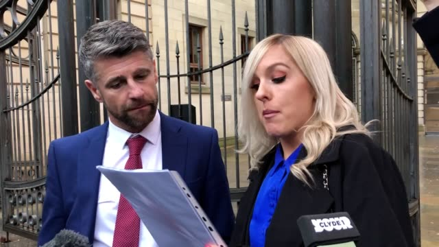 motherwell manager stephen robinson and his partner robyn lauchlan as she gives a statement outside court after he was cleared of domestic abuse... - pinning stock videos & royalty-free footage