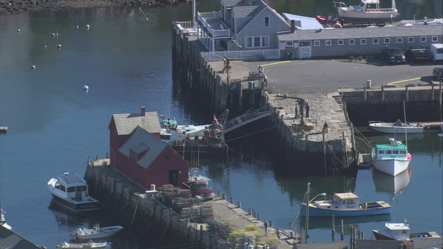 aerial motif number 1 fishing shack at bradley wharf / rockport, massachusetts, united states - rockport massachusetts stock videos & royalty-free footage
